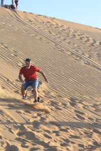 Sand-boarding in the Arabian Desert