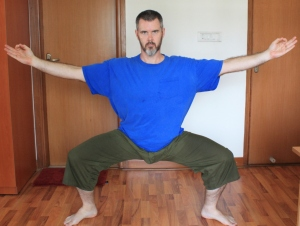 Goddess pose with hands in Chin mudra.