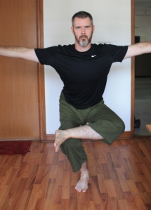 Version 1 begins and ends in Pranamasana (hands in prayer pose) With hands out to the side in between.