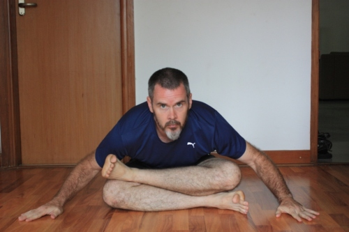Place one foot on top of the opposite knee (and vice versa for the other side) carefully shift weight forward. This puts an intense stretch on the hip joint to help rotate the thigh sufficiently