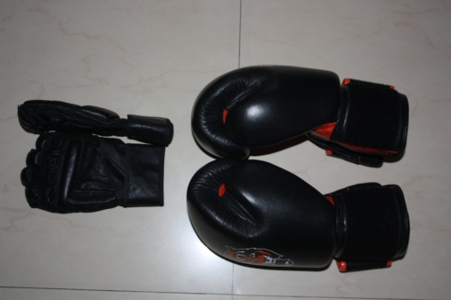 MMA style gloves on the left and 16oz. boxing gloves on the right