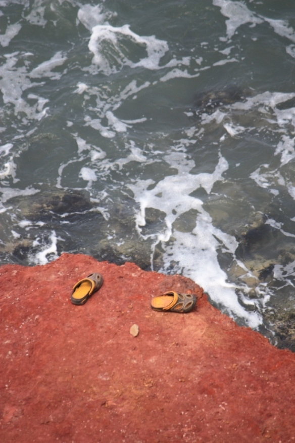 Someone may have been knocked out of their crocs by the waves.