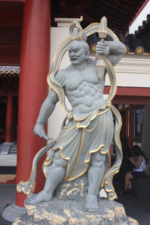 Guardian at front entrance. Note: Even if you have 6 pack abs, you're an 18 pack shy of being on par with this guy.